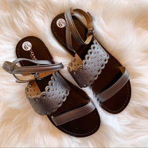 Coach Clarabel studded flat sandals